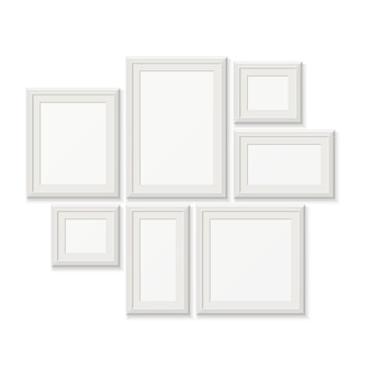 Empty white picture frames, 3d photo borders isolated on white wall. set of frames for photo