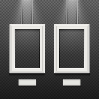 Empty white poster frames isolated on transparent checkered wall