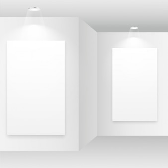 Empty white room with picture frames