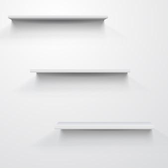 Empty white shelves on light grey
