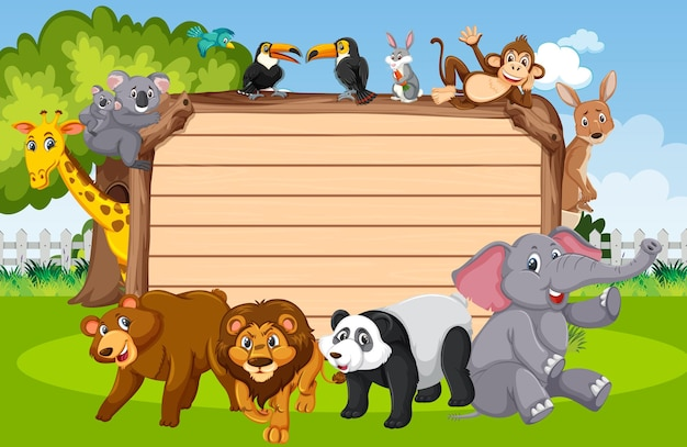 Empty wooden board with various wild animals in the forest