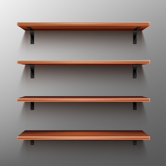 Empty wooden shelves on gray wall