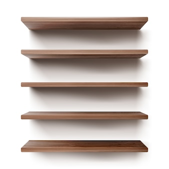 Empty wooden shelves on white wall