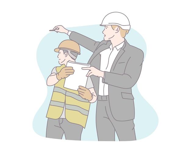 エンジニアと建設現場に立っている建設スタッフ