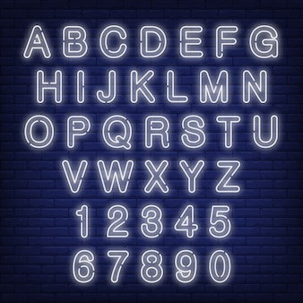 English alphabet and numbers. neon sign with white letters.
