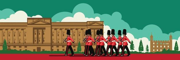 English soldier walk front of buckingham palace