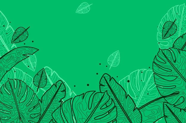 手描きの熱帯の葉の背景を彫刻