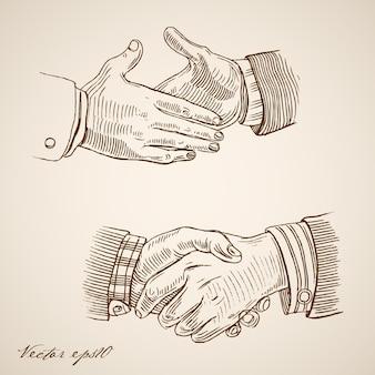 Engraving vintage hand drawn handshake