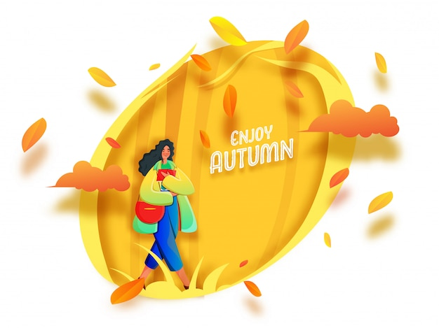 Enjoy autumn font with young girl holding book, side bag and paper leaves decorated on yellow and white background.
