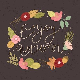 美しい花の背景と秋のレタリングを楽しむ
