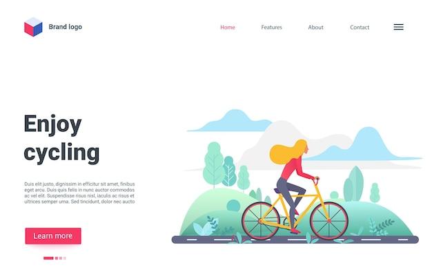 自然の風景の中のアスファルト道路で自転車に乗って自転車に乗る着陸ページのサイクリストをお楽しみください