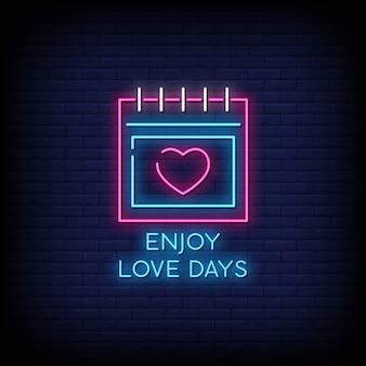 Enjoy love days neon signboard on brick wall