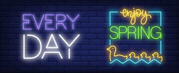 Enjoy spring every day neon sign. mother and baby ducks floating on water.