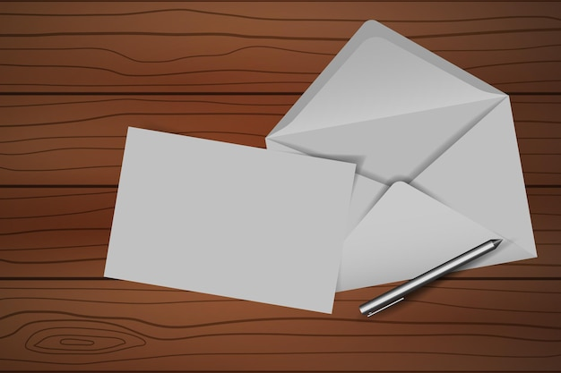 Envelope with blank note and pen on wooden table