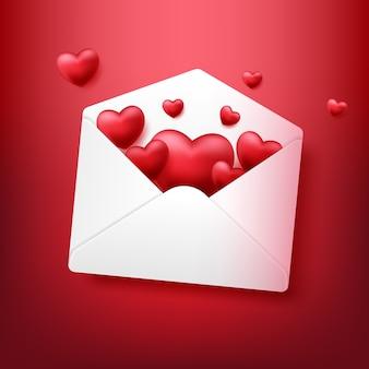 赤い背景で隔離の心と封筒