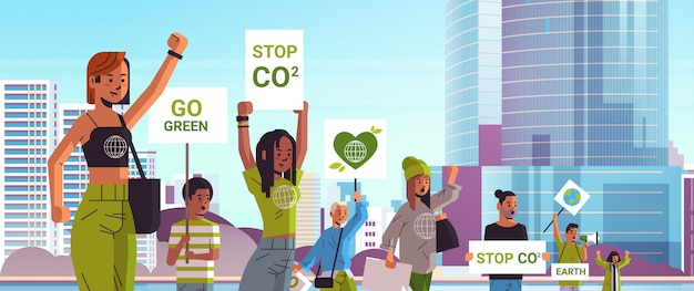 Environmental activists holding posters go green save planet strike concept protesters campaigning to protect earth demonstrating against global warming portrait cityscape background horizontal
