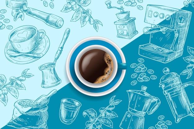 青い手描きの背景にエスプレッソコーヒーカップ