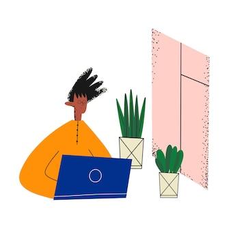 Этнический деловой человек работает за ноутбуком и смотрит в окно