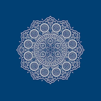 Ethnic delicate white lace mandala on blue