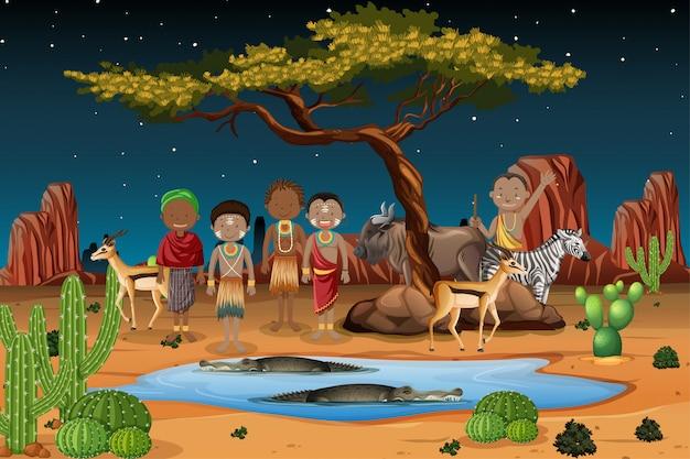 自然の背景の伝統的な服でアフリカの部族の民族の人々 Premiumベクター