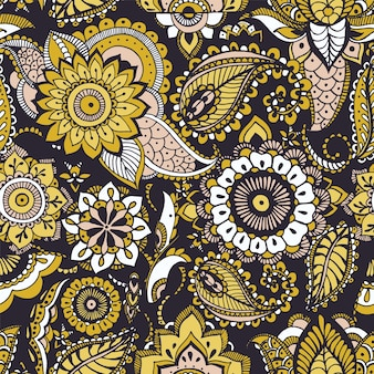 Ethnic seamless pattern with yellow buta motifs and persian floral mehndi elements on black