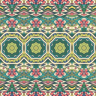 生地の民族部族のお祭りパターン。装飾的な抽象的な幾何学的なカラフルなシームレスパターン。
