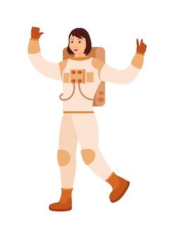 白い背景の上の宇宙服で興奮した女性宇宙飛行士