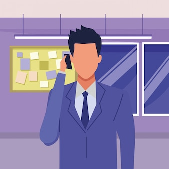 Executive businessman talking on phone and holding briefcase