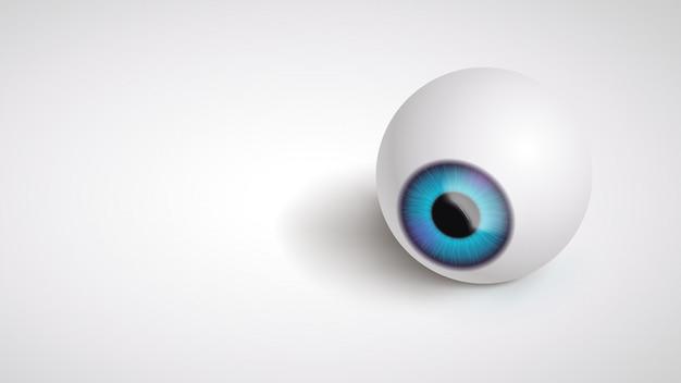 灰色の上に横たわる眼球