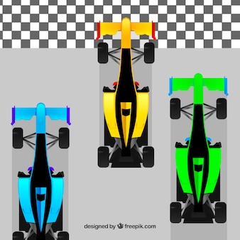 F1 racing cars of different colors crossing finish line