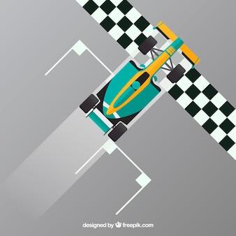グリーンf1レーシングカーがフィニッシュラインを横切る