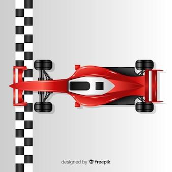 シャイニーレッドf1レーシングカーがフィニッシュラインを横切る