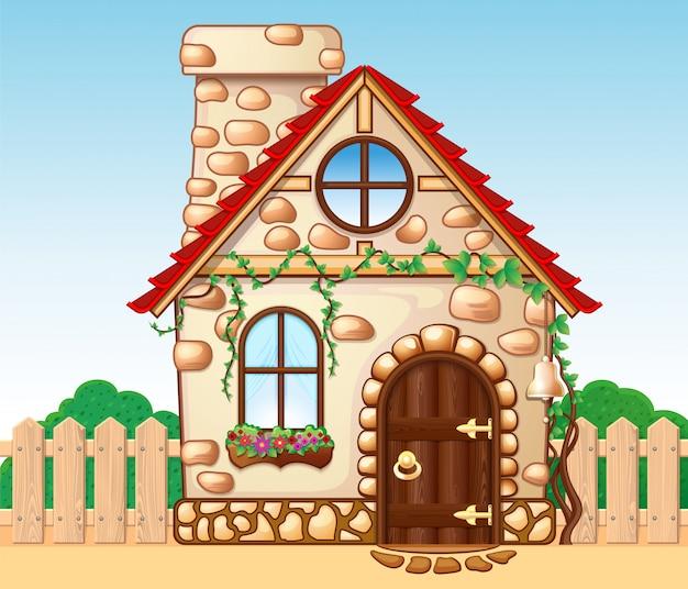 木製のフェンスと素晴らしい居心地の良い家。