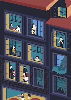 열린 창문과 내부에 사는 사람들이있는 건물의 외관.