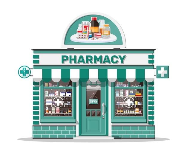 看板のあるファサード薬局店。ドラッグストアの外観。薬の丸薬カプセル、ボトル、ビタミン、タブレットをショーケースに。店先の店の建物、通りの建築。