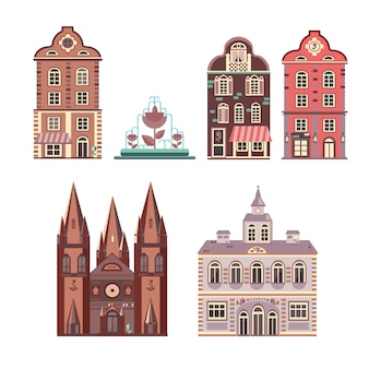 Facades of five buildings of european style architecture and cute fountain.