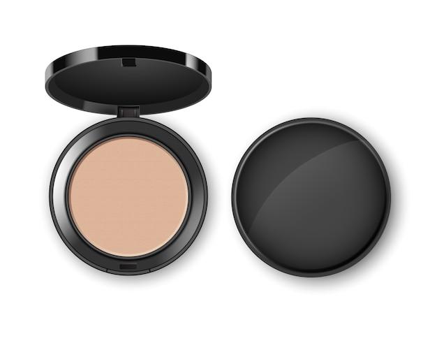 白い背景に分離された黒い丸いプラスチックケース上面で化粧品化粧パウダーを顔します。