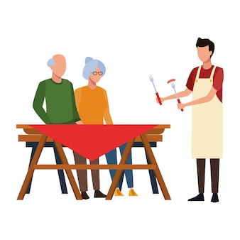 Faceless grandparents barbecue table