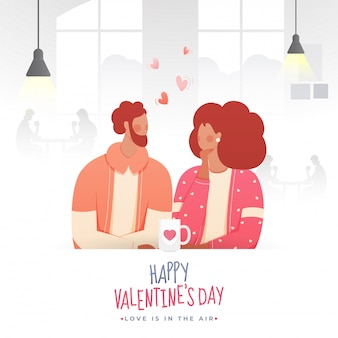 Faceless young couple drinking tea or coffee in cafe on the occasion of happy valentine's day, love is in the air.