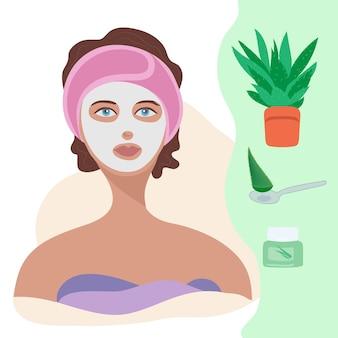 Уход за лицом для женщин молодая женщина, применяя глиняную маску для лица на лице