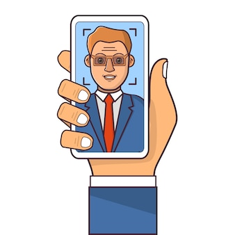 Facial recognition system.face id.human hand holding smartphone.businessman in a suit. biometric authentication.