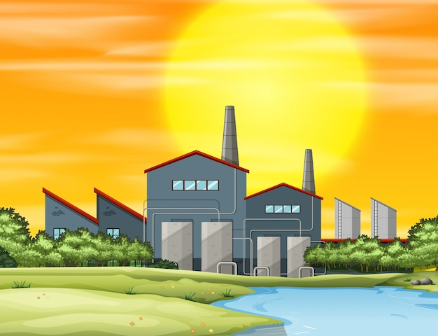 Factory with pollution at sunset