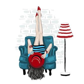 Женщина fahion подняла ноги на стене