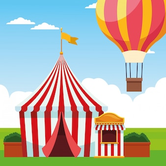 Fair tent and hot air balloon over landscape