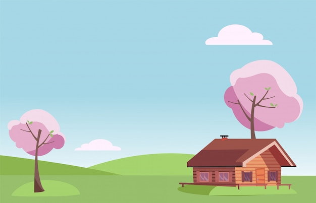Fair weather spring landscape with small country wooden house and blooming pink trees on the green grass hills