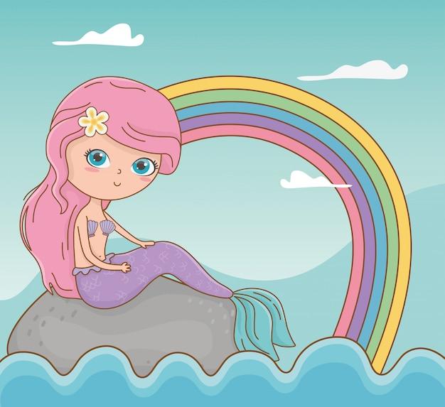 Scena di paesaggio marino da favola con sirena e arcobaleno