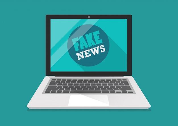 Fake news word on laptop