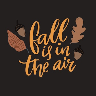 Fall is in the air. inspirational autumn quote, brown leaves and acorns illustrations.