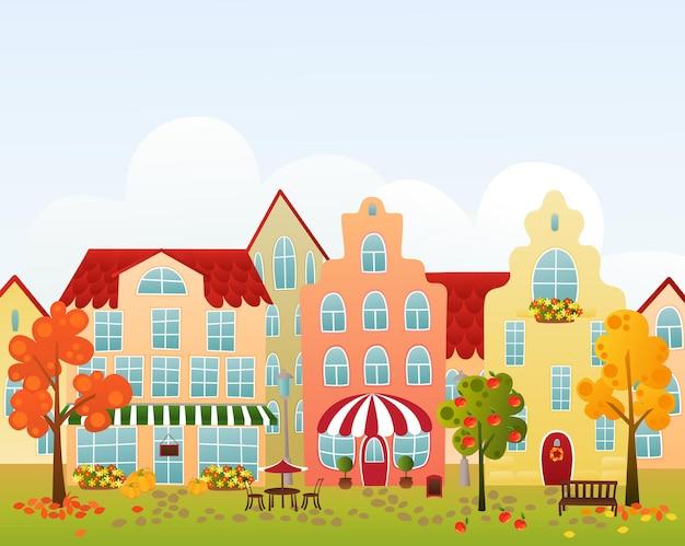 상점, 카페, 호텔이있는 가을 마을 거리