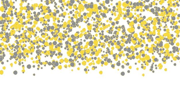 落下する紙吹雪。黄色と灰色のドットの背景。